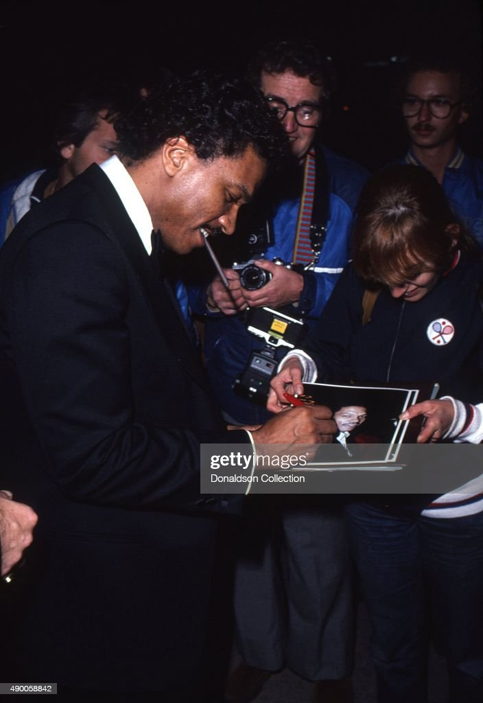 Actor Billie Dee Williams signs an autograph as he attends an event in March 1981 in Los Angeles California