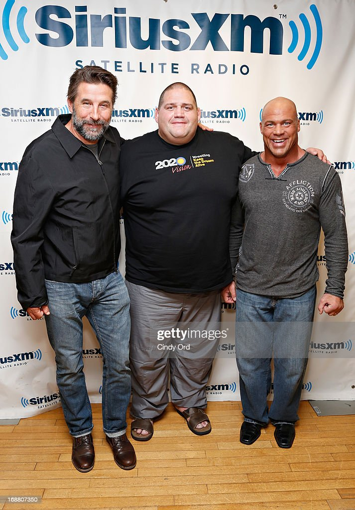 Actor Billy Baldwin poses with wrestlers Rulon Gardner and Kurt Angle at the SiriusXM Studios on May 15 2013 in New York City