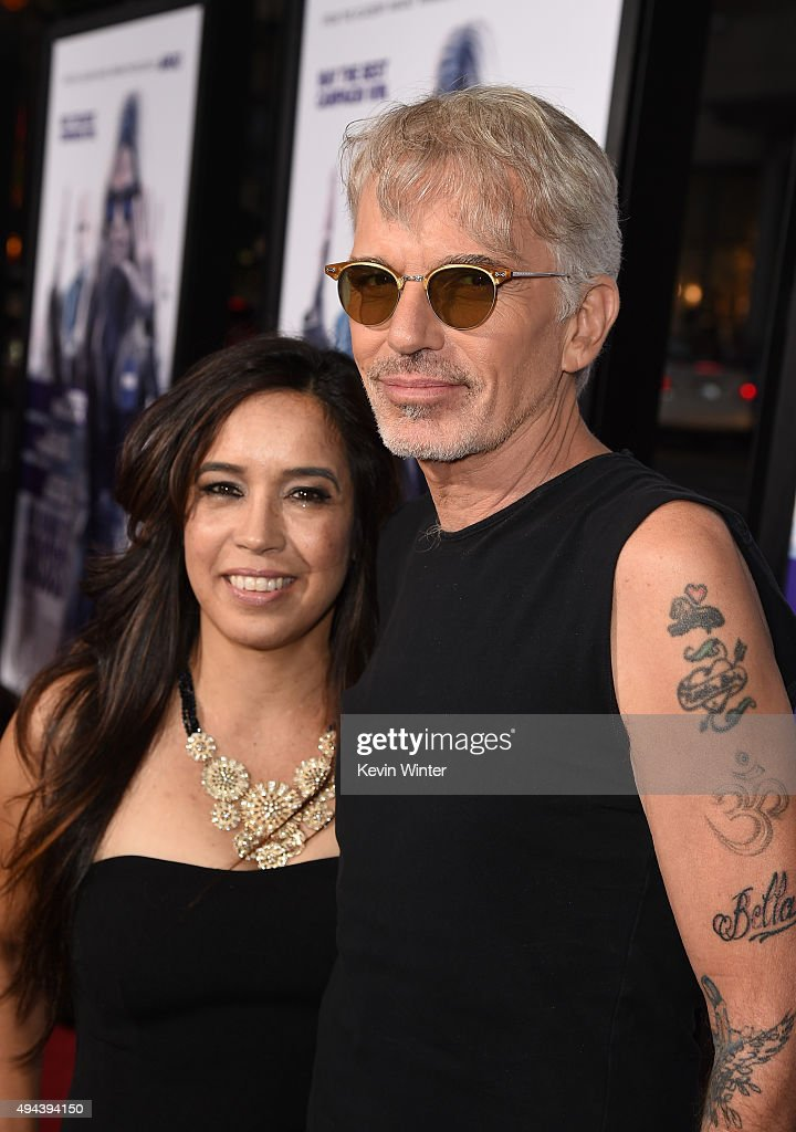 Actor Billy Bob Thornton (R) and Connie Angland attend the premiere of Warner Bros. Pictures' 'Our Brand Is Crisis' at TCL Chinese Theatre on October 26, 2015 in Hollywood, California.