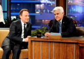 Actor Billy Crystal and comedian Jay Leno appear onstage during a commercial break on the final episode of 'The Tonight Show with Jay Leno' at The...