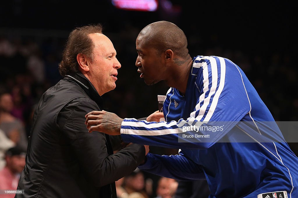 Actor Billy Crystal greets Jamal Crawford #11 of the Los Angeles Clippers prior to the game against the Brooklyn Nets at the Barclays Center on November 23, 2012 in the Brooklyn borough of New York City.