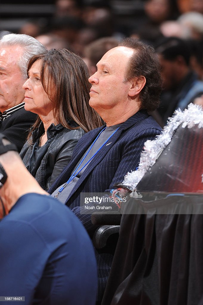 Actor Billy Crystal looks on as the Denver Nuggets play the Los Angeles Clippers during a Christmas Day game at Staples Center on December 25, 2012 in Los Angeles, California.