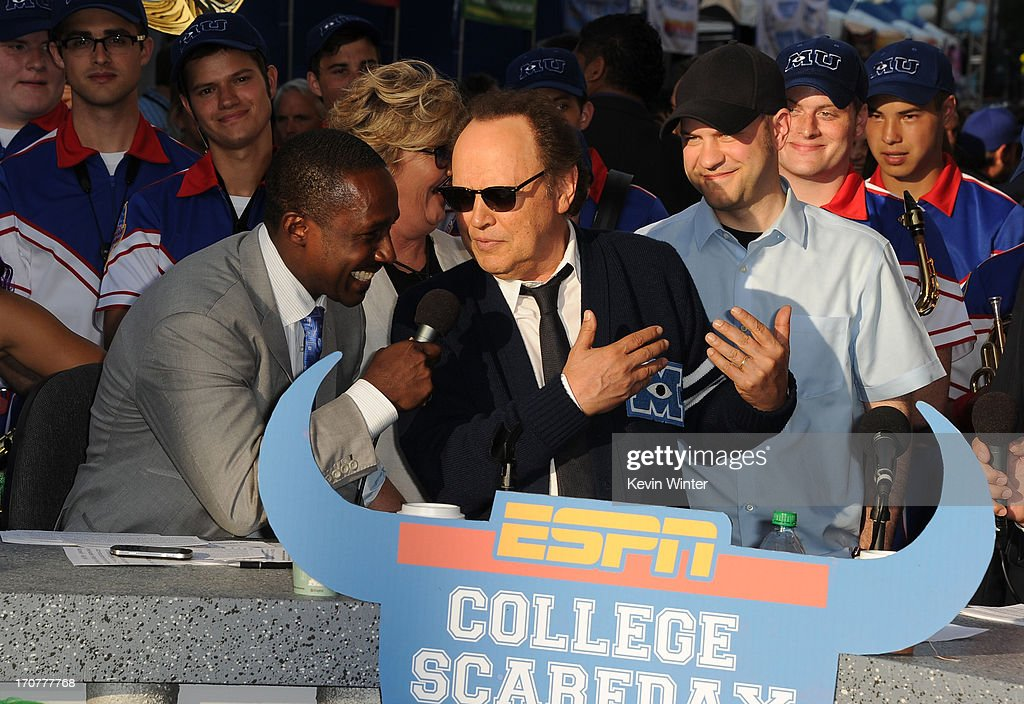 Actor Billy Crystal speaks to ESPN College Scoreday commentator Desmond Howard at the world premiere of Disney Pixar's 'Monsters University' at the El Capitan Theatre on June 17, 2013 in Hollywood, California.