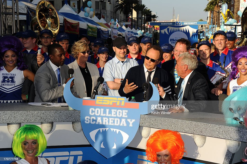 Actor Billy Crystal (seated 2nd from right) speaks to ESPN College Scoreday commentator Lee Corso at the world premiere of Disney Pixar's 'Monsters University' at the El Capitan Theatre on June 17, 2013 in Hollywood, California.