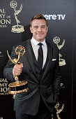 Actor Billy Miller poses in the press room at the 41st Annual Daytime Emmy Awards at The Beverly Hilton Hotel on June 22 2014 in Beverly Hills...