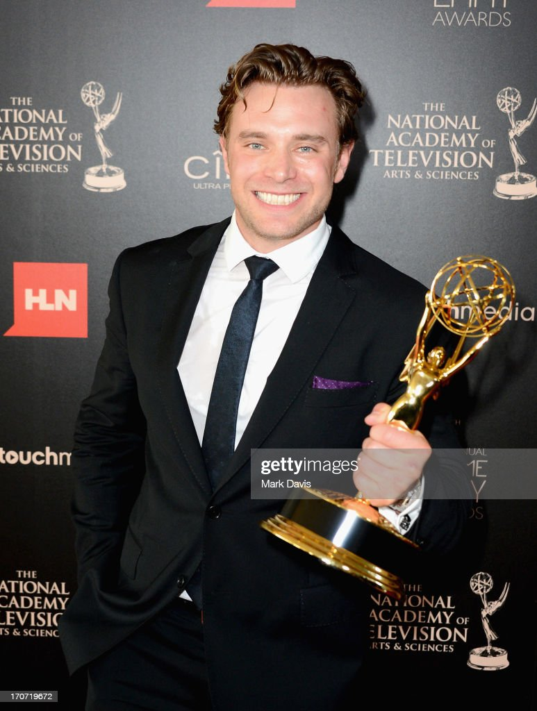 Actor <a gi-track='captionPersonalityLinkClicked' href=/galleries/search?phrase=Billy+Miller+-+Actor&family=editorial&specificpeople=12915047 ng-click='$event.stopPropagation()'>Billy Miller</a> poses with the Outstanding Supporting Actor in a Drama Series award for 'The Young and the Restless' in the press room during The 40th Annual Daytime Emmy Awards at The Beverly Hilton Hotel on June 16, 2013 in Beverly Hills, California.