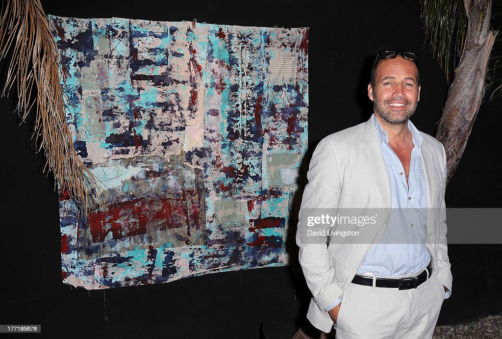 Actor Billy Zane poses with his artwork at the opening night of Billy Zane's 'Seize The Day Bed' solo art exhibition at G+ Gulla Jonsdottir Design on August 21, 2013 in Los Angeles, California.