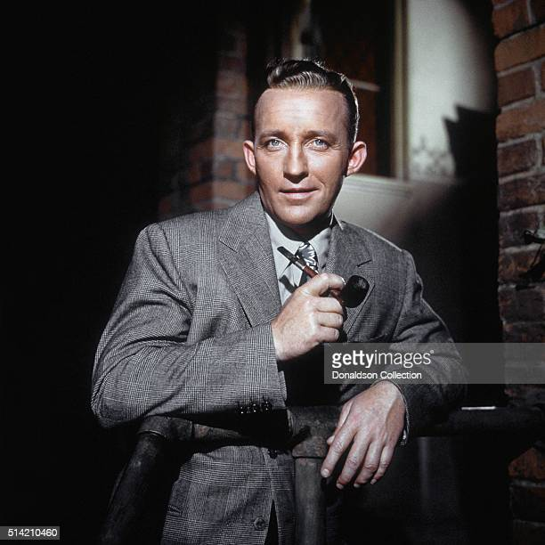 Actor Bing Crosby poses for a portrait with pipe in circa 1950