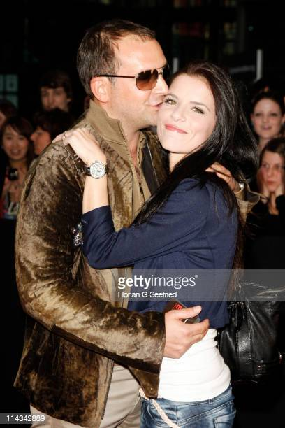 Actor Bjoern Casapietra and girlfriend Anne Kathrin Wagner attend the 'Grand Opening Cinema Berlin' with the screening of 'Pirates Of The Caribbean...