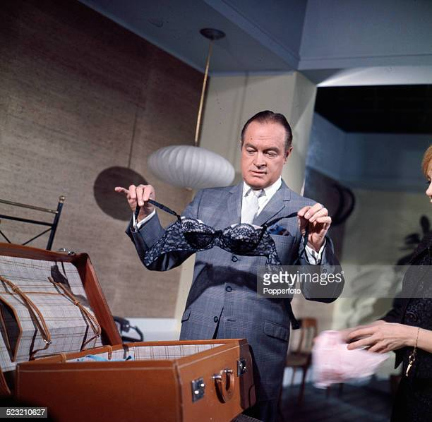 Actor Bob Hope holds a bra whilst unpacking a suitcase in a scene from the film 'Call Me Bwana' in production at Pinewood Studios in England in 1963