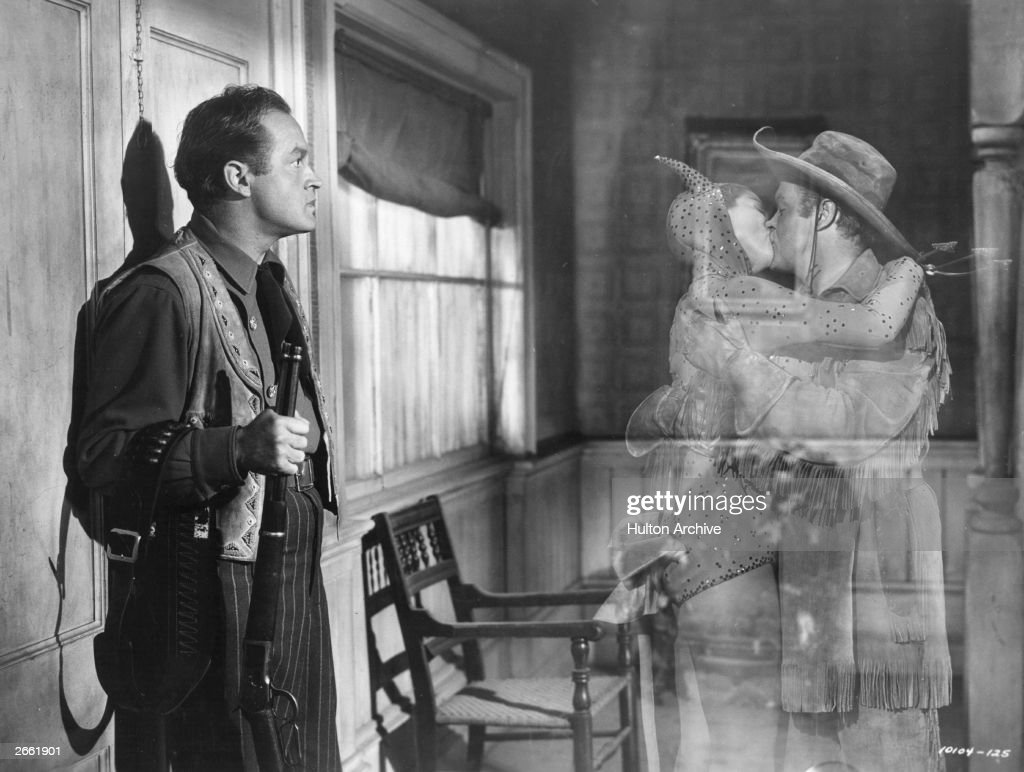 Actor Bob Hope sees his ghost locked in a passionate embrace with a woman dressed as the devil in the film 'Son Of Paleface' directed by Frank Tashlin