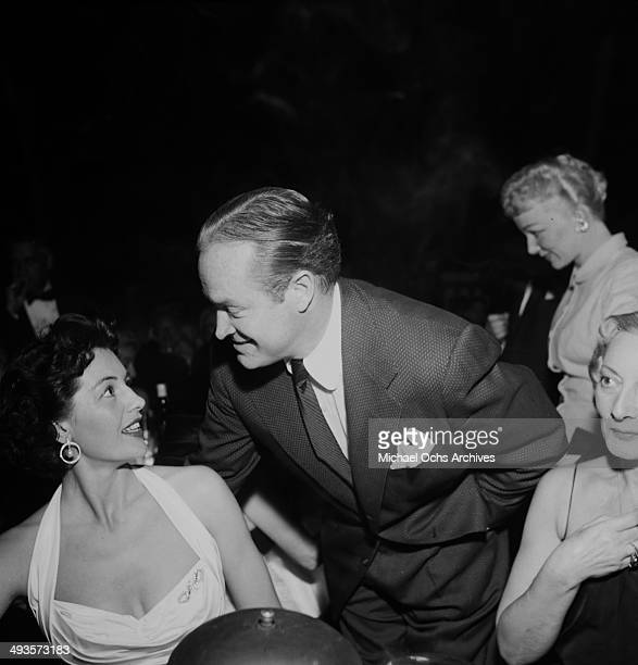 Actor Bob Hope talks to Cyd Charisse at the Cocoanut Grove in Los Angeles California