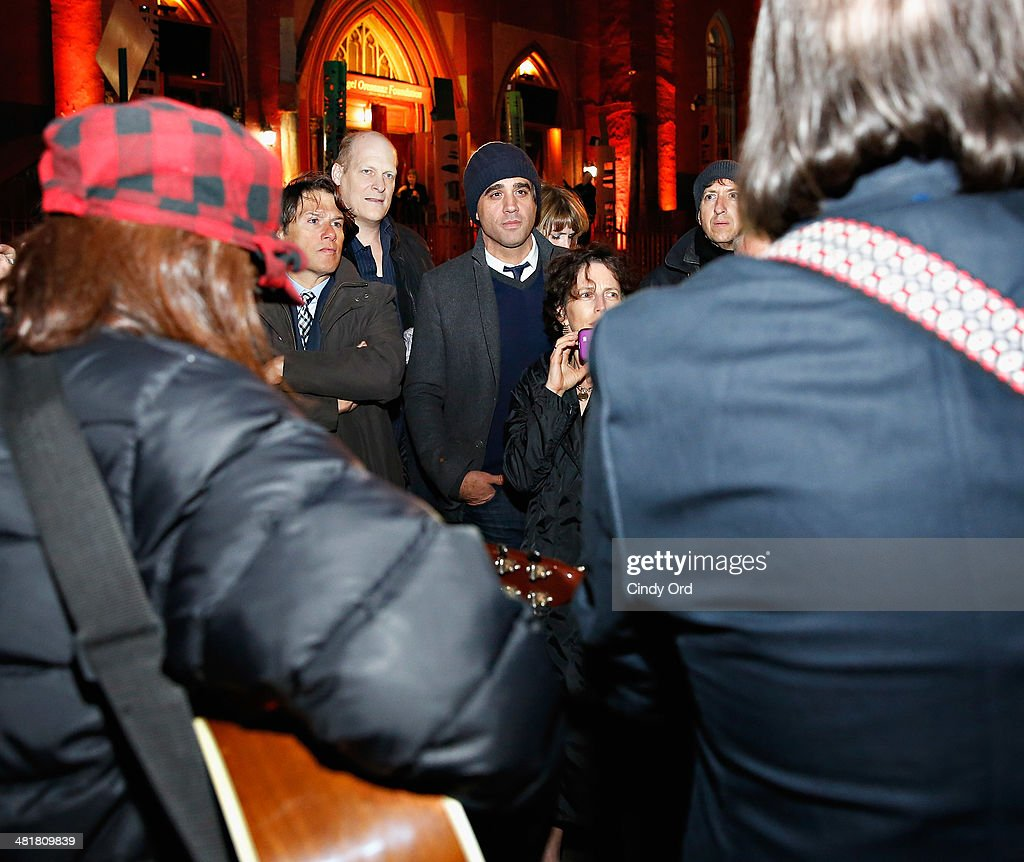 Actor <a gi-track='captionPersonalityLinkClicked' href=/galleries/search?phrase=Bobby+Cannavale&family=editorial&specificpeople=211166 ng-click='$event.stopPropagation()'>Bobby Cannavale</a> (C) is seen watching a performance by singer Steve Earle on Norfolk Street following an evacuation of Soho Rep's 2014 Spring Fete at Angel Orensanz Center after structural issues were discovered in the building on March 31, 2014 in New York City. Approximately 300 people had to be evacuated from the Angel Orensanz Center after several columns were discovered to have cracks, however there were no injuries reported and the benefit continued outdoors.