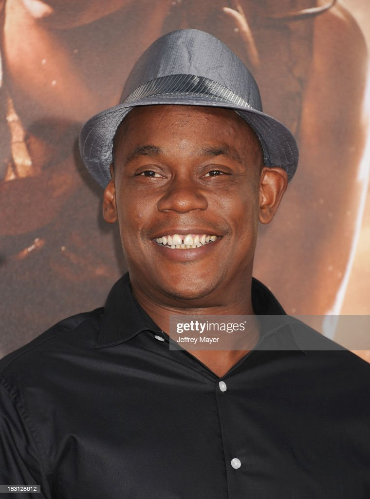 Actor Bokeem Woodbine arrives at the Los Angeles premiere of 'Riddick' at the Westwood Village Theatre on August 28, 2013 in Westwood, California.