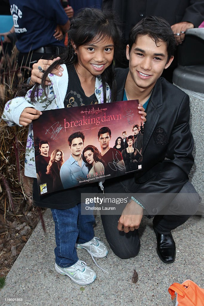 Actor Boo Boo Stewart (R) surprises 'Twilight' fans at the break of dawn during 2011 Comic-Con International Day 1 at San Diego Convention Center on July 21, 2011 in San Diego, California.