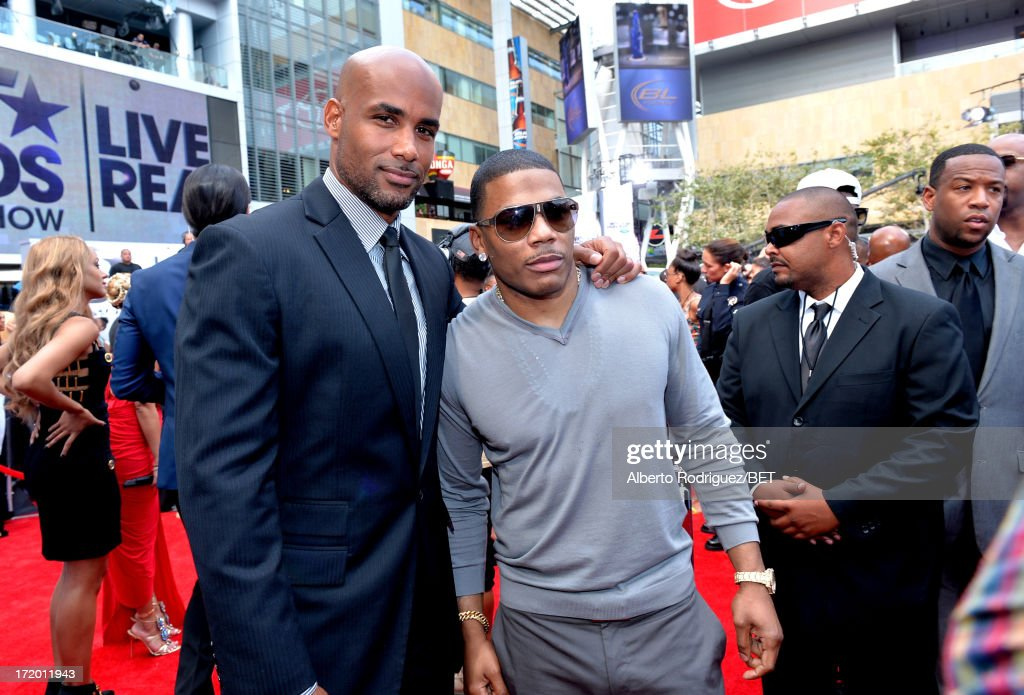 Actor <a gi-track='captionPersonalityLinkClicked' href=/galleries/search?phrase=Boris+Kodjoe&family=editorial&specificpeople=240156 ng-click='$event.stopPropagation()'>Boris Kodjoe</a> (L) and <a gi-track='captionPersonalityLinkClicked' href=/galleries/search?phrase=Nelly+-+Rapper&family=editorial&specificpeople=11499081 ng-click='$event.stopPropagation()'>Nelly</a> attend the P&G Red Carpet Style Stage at the 2013 BET Awards at Nokia Theatre L.A. Live on June 30, 2013 in Los Angeles, California.