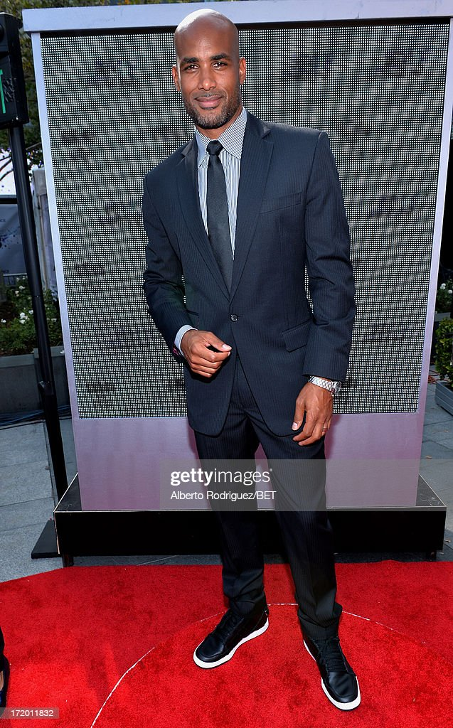 Actor <a gi-track='captionPersonalityLinkClicked' href=/galleries/search?phrase=Boris+Kodjoe&family=editorial&specificpeople=240156 ng-click='$event.stopPropagation()'>Boris Kodjoe</a> attends the P&G Red Carpet Style Stage at the 2013 BET Awards at Nokia Theatre L.A. Live on June 30, 2013 in Los Angeles, California.