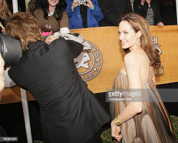 Actor Brad Pitt and Actress Angelina Jolie arrive to the TNT/TBS broadcast of the 14th Annual Screen Actors Guild Awards at the Shrine Auditorium on...