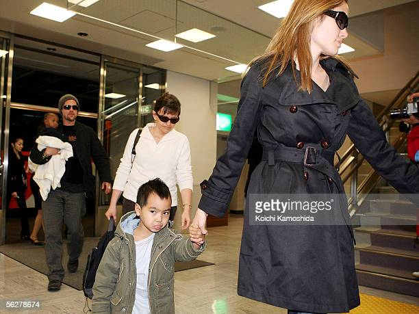 Actor Brad Pitt and actress Angelina Jolie arrive with Jolie's children Zahara Marley Jolie and Maddox Jolie at the New Tokyo International Airport...