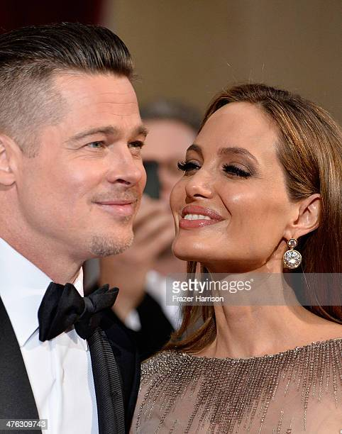 Actor Brad Pitt and actress Angelina Jolie attend the Oscars held at Hollywood Highland Center on March 2 2014 in Hollywood California