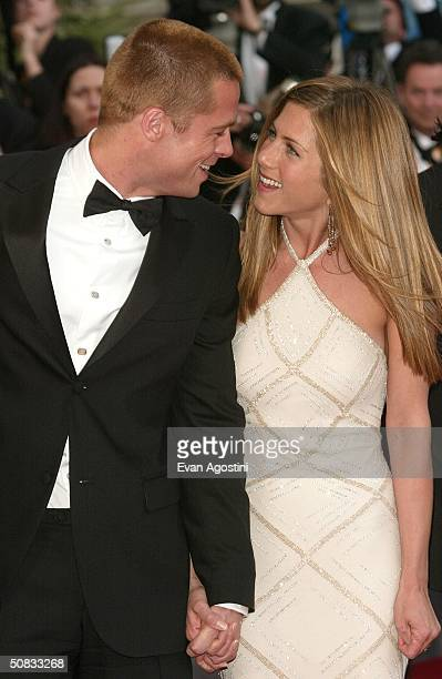 Actor Brad Pitt and wife actress Jennifer Aniston attend the World Premiere of the epic movie 'Troy' at Le Palais de Festival on May 13 2004 in...
