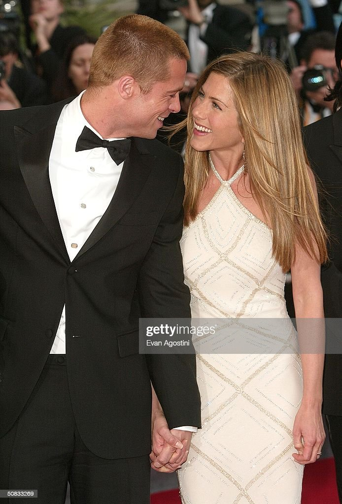 Actor <a gi-track='captionPersonalityLinkClicked' href=/galleries/search?phrase=Brad+Pitt+-+Actor&family=editorial&specificpeople=201682 ng-click='$event.stopPropagation()'>Brad Pitt</a> and wife actress <a gi-track='captionPersonalityLinkClicked' href=/galleries/search?phrase=Jennifer+Aniston&family=editorial&specificpeople=202048 ng-click='$event.stopPropagation()'>Jennifer Aniston</a> attend the World Premiere of the epic movie 'Troy' at Le Palais de Festival on May 13, 2004 in Cannes, France. Aniston wears a dress by Versace.