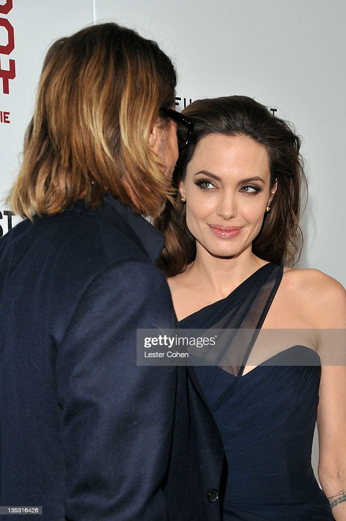 Actor Brad Pitt (L) and writer/director Angelina Jolie arrive at 'In the Land of Blood and Honey' premiere held at ArcLight Cinemas on December 8, 2011 in Hollywood, California.
