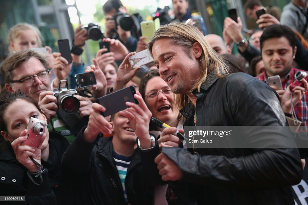 Actor <a gi-track='captionPersonalityLinkClicked' href=/galleries/search?phrase=Brad+Pitt+-+Actor&family=editorial&specificpeople=201682 ng-click='$event.stopPropagation()'>Brad Pitt</a> greets fans and signs autographs upon his arrival at the 'WORLD WAR Z' Germany Premiere at Sony Centre on June 4, 2013 in Berlin, Germany.