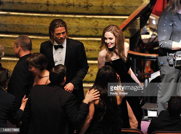 Actor Brad Pitt L0 and actress Angelina Jolie attend the 84th Annual Academy Awards held at the Hollywood Highland Center on February 26 2012 in...