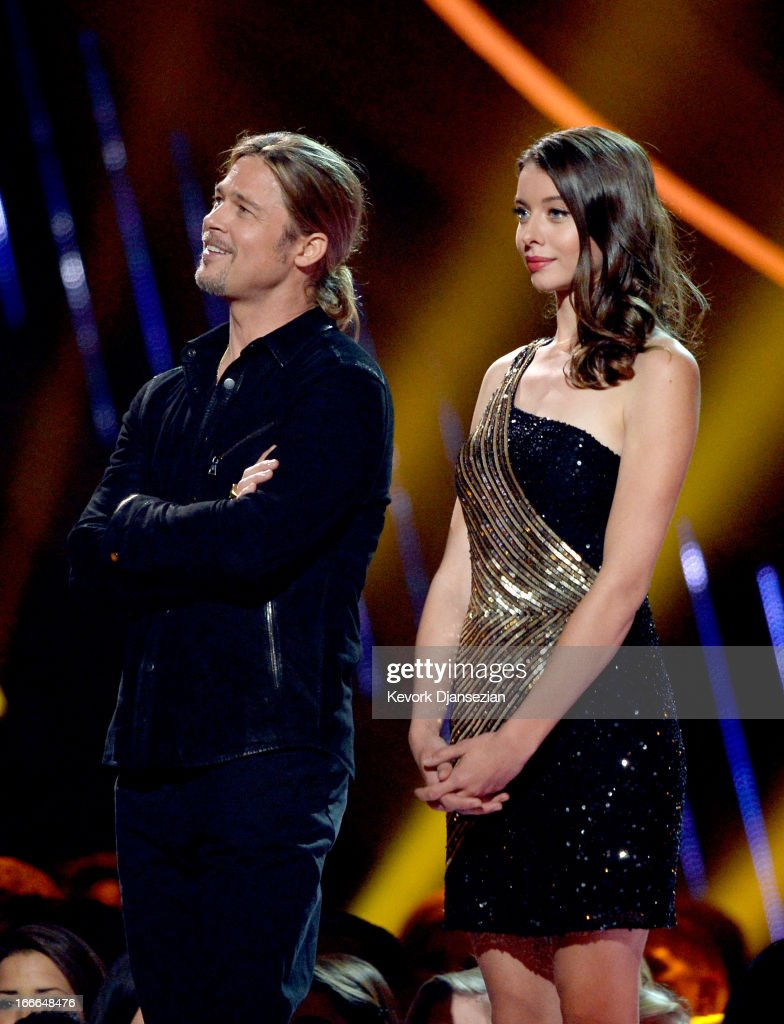 Actor Brad Pitt (L) onstage during the 2013 MTV Movie Awards at Sony Pictures Studios on April 14, 2013 in Culver City, California.