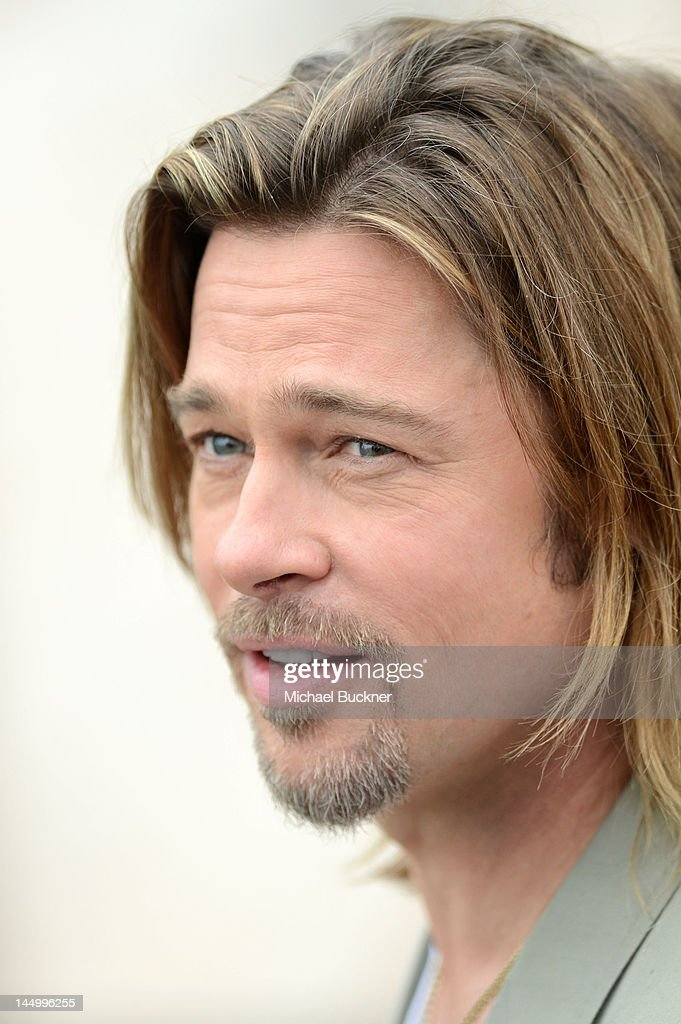 Actor Brad Pitt poses at the 'Killing Them Softly' photocall during the 65th Annual Cannes Film Festival at Palais des Festivals on May 22, 2012 in Cannes, France.