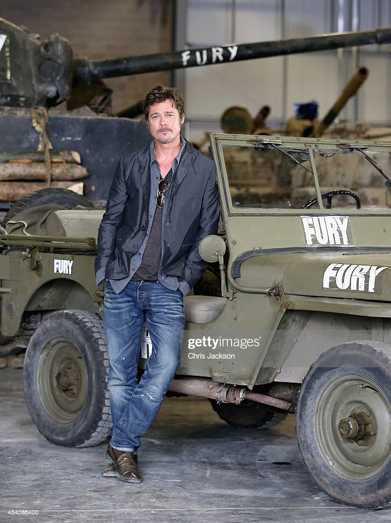 Actor <a gi-track='captionPersonalityLinkClicked' href=/galleries/search?phrase=Brad+Pitt+-+Actor&family=editorial&specificpeople=201682 ng-click='$event.stopPropagation()'>Brad Pitt</a> poses in front of a Sherman Tank during a photocall for the film 'Fury' at Bovington Tank Museum on August 28, 2014 in Bovington, England. Columbia Pictures celebrated the upcoming film Fury with the films stars, <a gi-track='captionPersonalityLinkClicked' href=/galleries/search?phrase=Brad+Pitt+-+Actor&family=editorial&specificpeople=201682 ng-click='$event.stopPropagation()'>Brad Pitt</a>, Logan Lerman, and Jon Bernthal, as well as the films writer-director David Ayer, producer Bill Block, and costume designer Owen Thornton at Bovington Tank Museum today. Fury will be released on 24 October 2014 in the UK and 17 October 2014 in the United States.