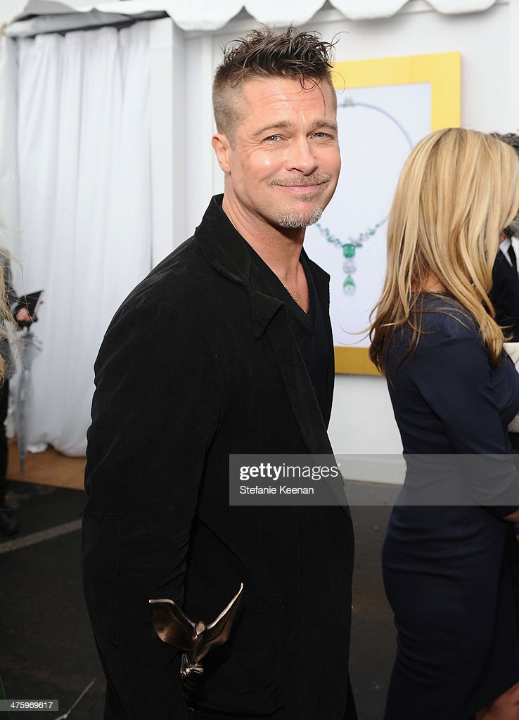 Actor Brad Pitt poses in the Piaget Lounge during the 2014 Film Independent Spirit Awards at Santa Monica Beach on March 1, 2014 in Santa Monica, California.