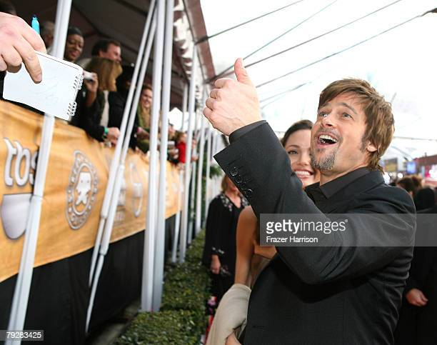 Actor Brad Pitt signs autographs during arrivals at the 14th annual Screen Actors Guild awards held at the Shrine Auditorium on January 27 2008 in...