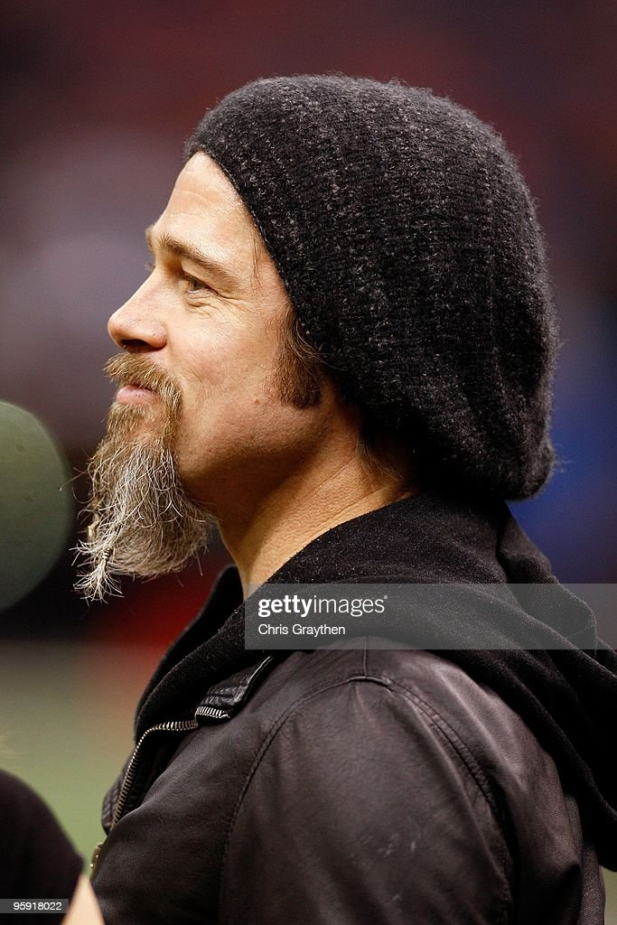 Actor <a gi-track='captionPersonalityLinkClicked' href=/galleries/search?phrase=Brad+Pitt+-+Actor&family=editorial&specificpeople=201682 ng-click='$event.stopPropagation()'>Brad Pitt</a> stands on the sidelines during warm ups prior to the New Orleans Saints hosting the Arizona Cardinals during the NFC Divisional Playoff Game at Louisana Superdome on January 16, 2010 in New Orleans, Louisiana.