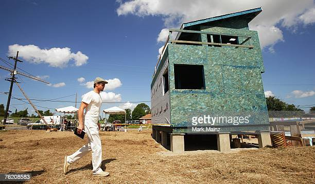 Actor Brad Pitt walks at the site of the Global Green USA's first house project at the Holy Cross Neigbourhood association project in the 9th ward...