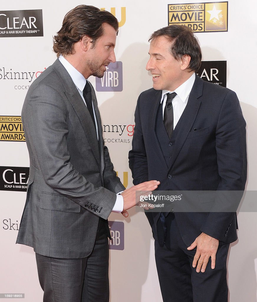Actor Bradley Cooper and director David O. Russell arrive at the 18th Annual Critics' Choice Movie Awards at Barker Hangar on January 10, 2013 in Santa Monica, California.
