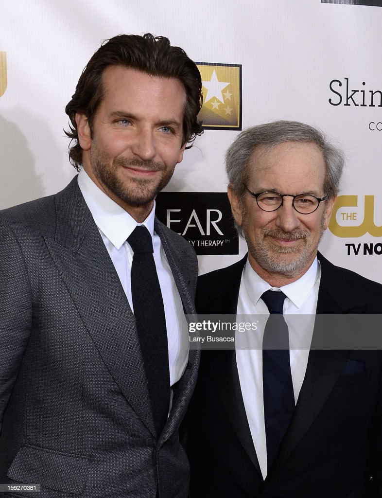 Actor <a gi-track='captionPersonalityLinkClicked' href=/galleries/search?phrase=Bradley+Cooper&family=editorial&specificpeople=680224 ng-click='$event.stopPropagation()'>Bradley Cooper</a> and director <a gi-track='captionPersonalityLinkClicked' href=/galleries/search?phrase=Steven+Spielberg&family=editorial&specificpeople=202022 ng-click='$event.stopPropagation()'>Steven Spielberg</a> attend the 18th Annual Critics' Choice Movie Awards held at Barker Hangar on January 10, 2013 in Santa Monica, California.