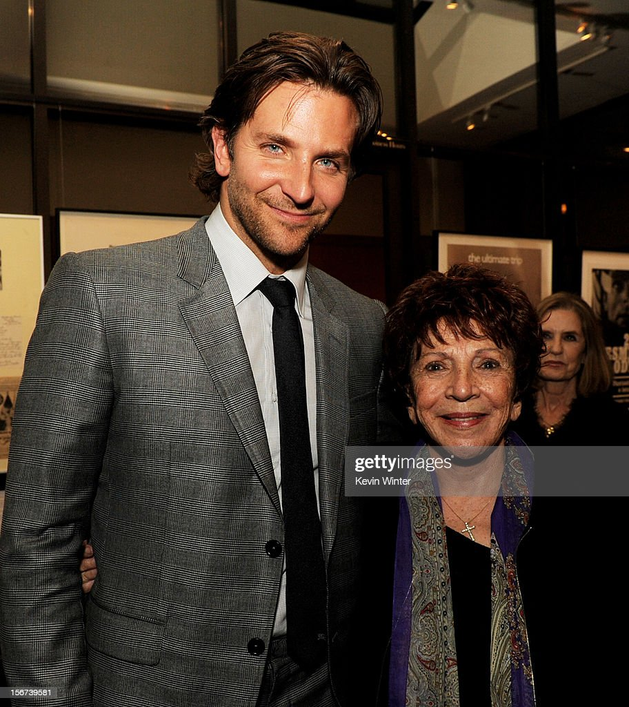 Actor Bradley Cooper (L) and Dr. Aida Takla-O'Reilly, president, Hollywood Foreign Press pose at the after party for a screening of The Weinstein Company's 'Silver Lining's Playbook' at the Academy of Motion Picture Arts and Sciences on November 19, 2012 in Beverly Hills, California.