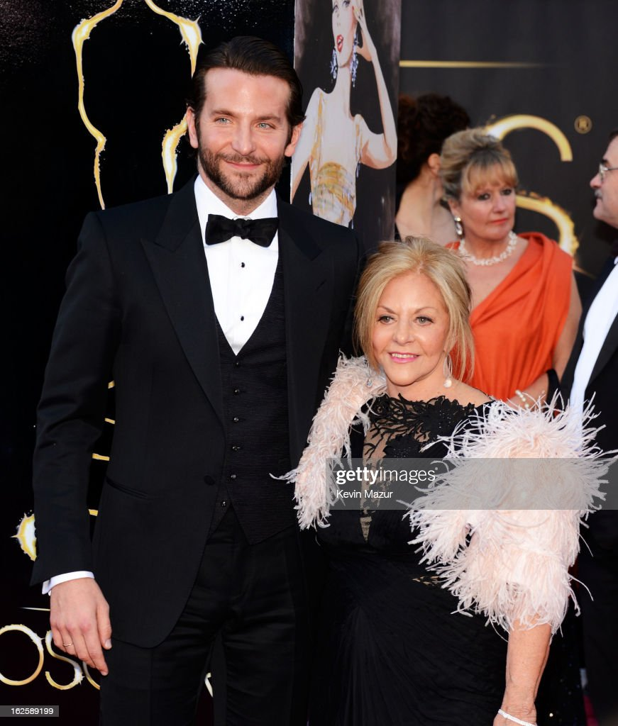Actor <a gi-track='captionPersonalityLinkClicked' href=/galleries/search?phrase=Bradley+Cooper&family=editorial&specificpeople=680224 ng-click='$event.stopPropagation()'>Bradley Cooper</a> (L) and mother Gloria Cooper arrive at the Oscars held at Hollywood & Highland Center on February 24, 2013 in Hollywood, California.