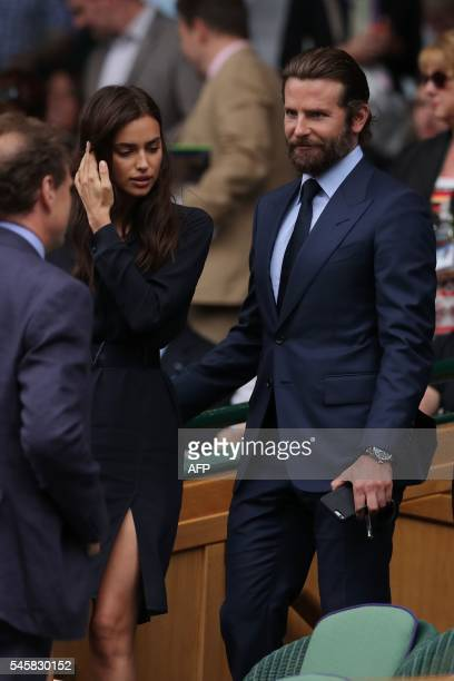 US actor Bradley Cooper and Russian model Irina Shayk arrive for the men's singles final match on the last day of the 2016 Wimbledon Championships at...