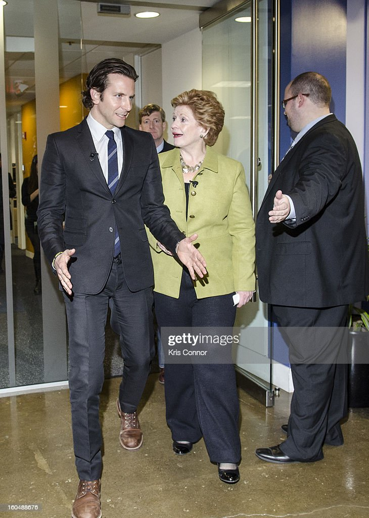 Actor Bradley Cooper and Senator Debbie Stabenow (D-MI) arrive to the 'Silver Lining Playbook' mental health progress press conference at Center For American Progress on February 1, 2013 in Washington, DC.