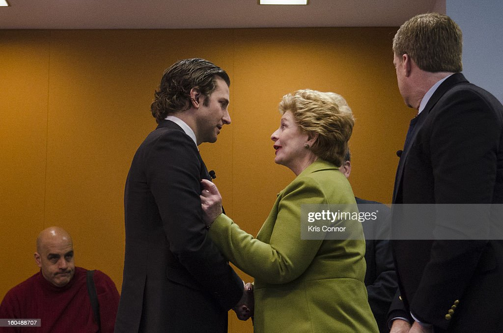 Actor Bradley Cooper and Senator Debbie Stabenow (D-MI) speak during the 'Silver Lining Playbook' mental health progress press conference at Center For American Progress on February 1, 2013 in Washington, DC.