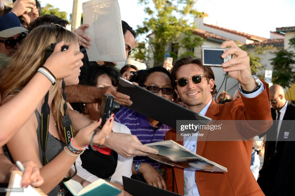 Actor <a gi-track='captionPersonalityLinkClicked' href=/galleries/search?phrase=Bradley+Cooper&family=editorial&specificpeople=680224 ng-click='$event.stopPropagation()'>Bradley Cooper</a> (R) arrives at the premiere of Warner Bros. Pictures' 'Hangover Part 3' on May 20, 2013 in Westwood, California.