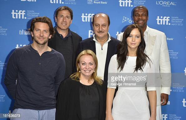 Actor Bradley Cooper director David O Russell actors Jacki Weaver Anupam Kher Jennifer Lawrence and Chris Tucker attend the 'Silver Linings Playbook'...