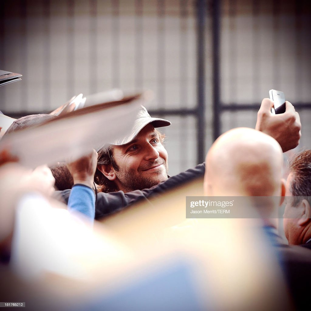 Image was processed using various digital filters) Actor <a gi-track='captionPersonalityLinkClicked' href=/galleries/search?phrase=Bradley+Cooper&family=editorial&specificpeople=680224 ng-click='$event.stopPropagation()'>Bradley Cooper</a> exits the 'Silver Linings Playbook' TIFF press conference on September 9, 2012 in Toronto, Canada.