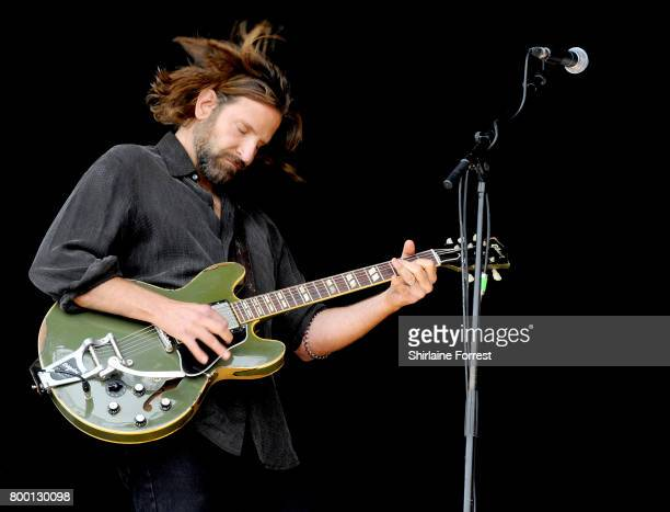 Actor Bradley Cooper is filmed performing and introducing Kris Kristofferson on the Pyramid stage on day 2 of the Glastonbury Festival 2017 at Worthy...