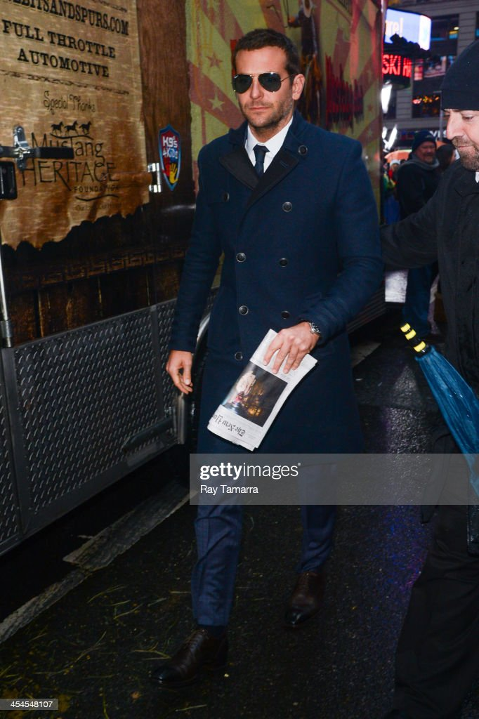 Actor Bradley Cooper leaves the 'Good Morning America' taping at the ABC Times Square Studios on December 9, 2013 in New York City.