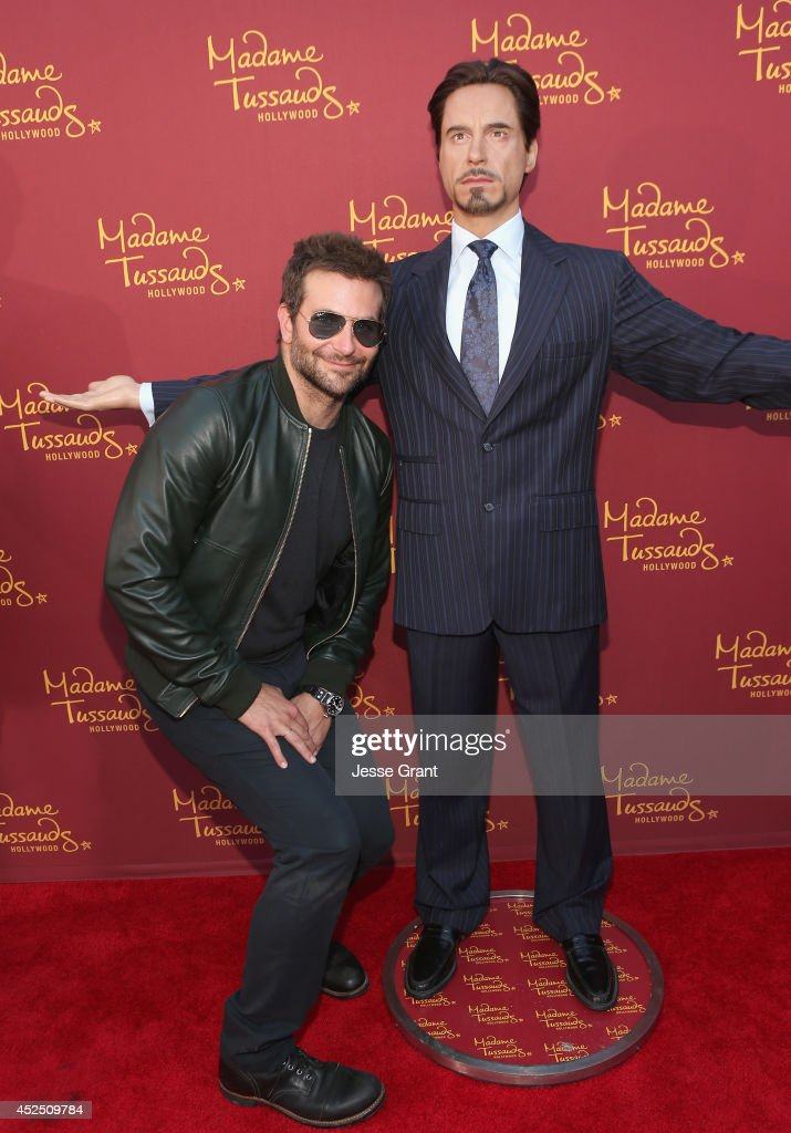 Actor Bradley Cooper poses alongside a Madame Tussauds Hollywood MARVEL wax figure during the 'Guardians of The Galaxy' premiere at the Dolby Theatre on July 21, 2014 in Hollywood, California.