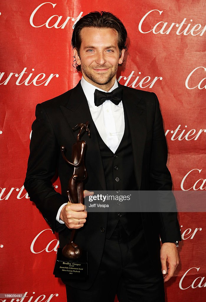 Actor <a gi-track='captionPersonalityLinkClicked' href=/galleries/search?phrase=Bradley+Cooper&family=editorial&specificpeople=680224 ng-click='$event.stopPropagation()'>Bradley Cooper</a> poses with the Desert Palm Achievement Award during the 24th annual Palm Springs International Film Festival Awards Gala at the Palm Springs Convention Center on January 5, 2013 in Palm Springs, California.
